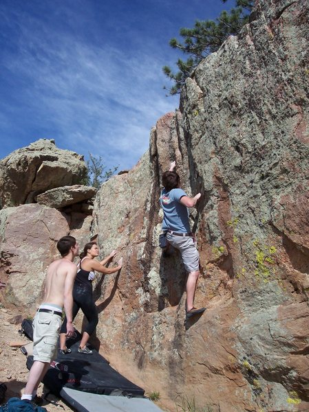 Tyson H. preparing for the crux, pulling off a two finger pocket.