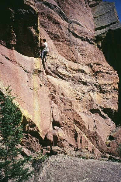 Tony B. starting into the dihedral on 'Everpresent Lane' (10d) in Fern Canyon of the Boulder Flatirons.<br> <br> Photo by Seth Muslin, 9/09.