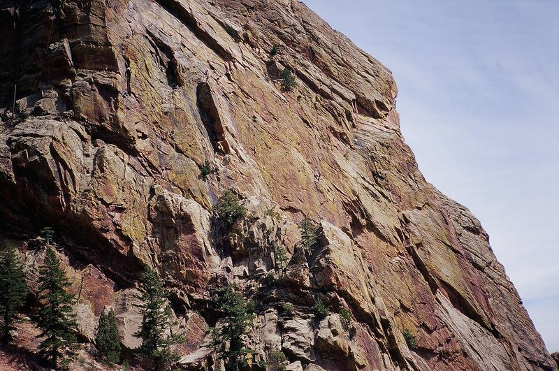 The South Face of Redgarden Wall as seen from the park road. The prominent dihedral left of center is the Rover dihedral. Photo by Tony B., 2007.