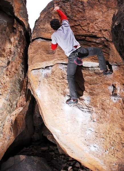 Sulli almost to the top after working the tricky opening moves on the undercling problem. Photo: Ross