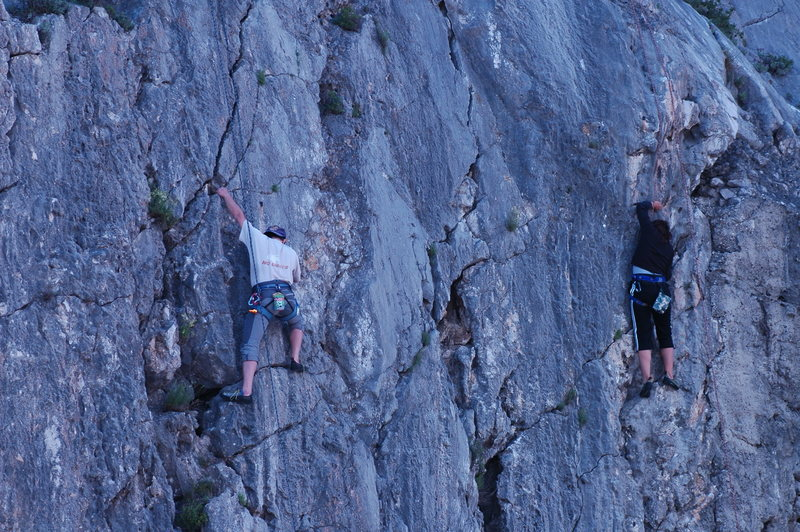 Climbers struggling on the same routes on top rop, with shoes.