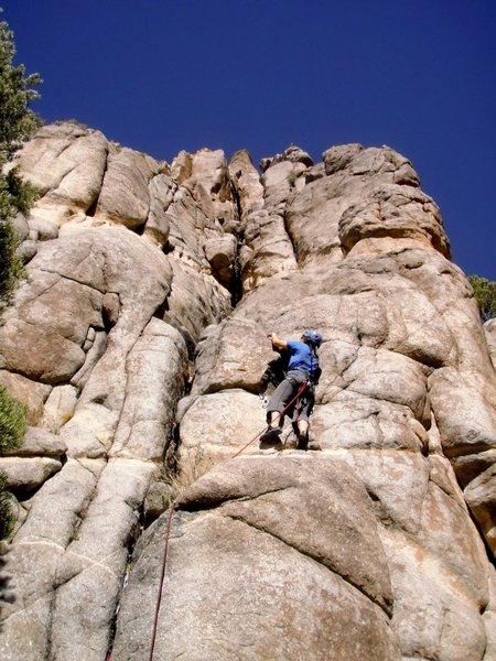 Following the route.  The rope goes up through the 5.9 finger crack.