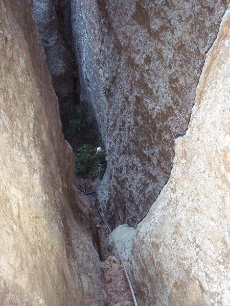 Looking down the waterchute/chimney at the top of Pitch 4. The crux 5.8 move is right at the bottom and is well protected.