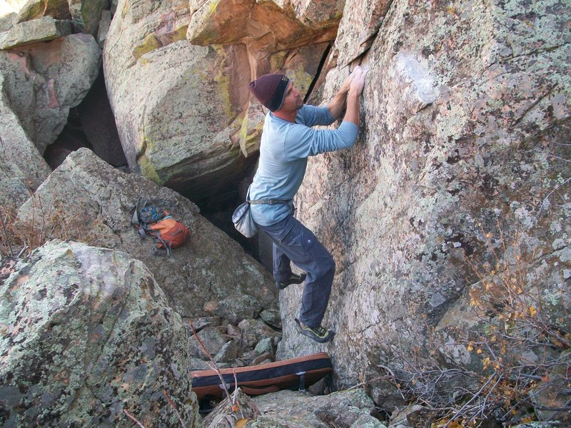 "Low Hanging Melons. <br> ""George"" ascends the slightly overhung face above and left of my packs."