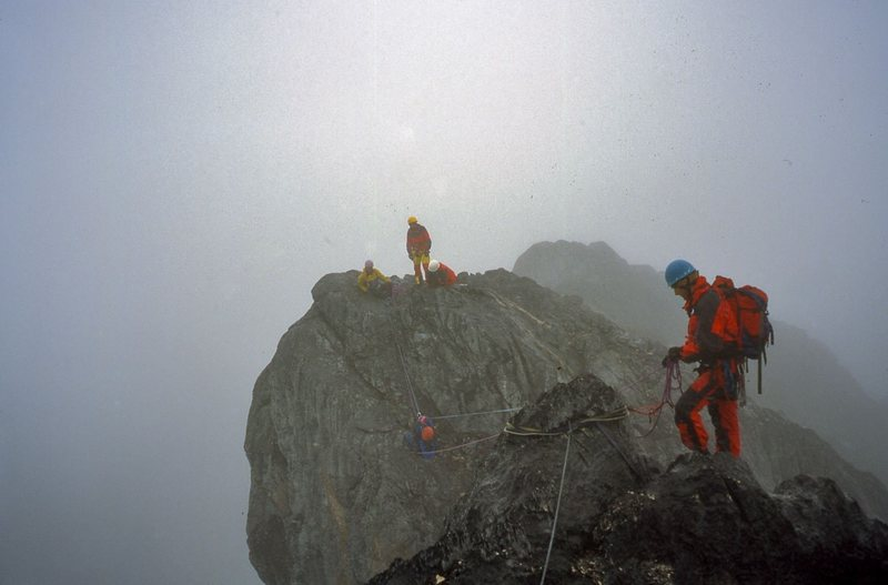 Climbing along the misty ridge.