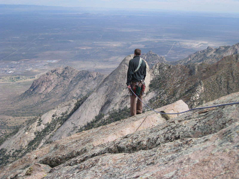 Aaron enjoys the view of Sugarloaf and the White Sands Missile Range from the summit block of Minerva's Temple.  October 2009.