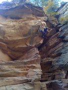 Rock Climbing Photo: Tiago heel hooking in the Cove.