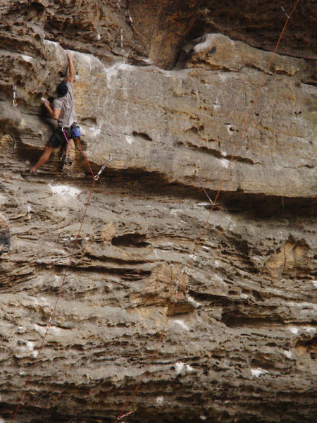 Rock Climbing Photo: Adrien sticking the commiting move before the midw...