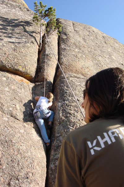 Ila in second pitch of Le Petit Arbre. The tree is not a rope hazard as this photo makes it seem.