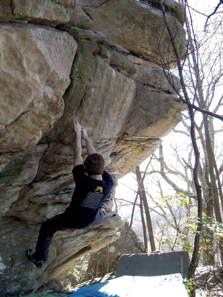 "Aaron Parlier going for the slopey pocket on the scary top out problem ""Deliverance"" (V-4) at the bluefield boulders, virginia"