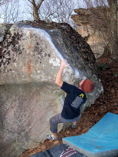 """Aaron Parlier beginning up the slopey, right-angle edge on """"Secant Line"""" (V-7+)"""