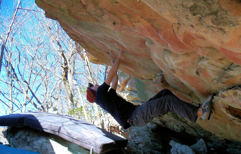 "Aaron Parlier climbing out of the ""Warm Up Roof"" (V-1) at the bluefield boulders Virginia/West Virginia"