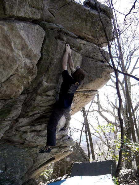 "Aaron Parlier about to begin the fun top out on ""Deliverance"" (V-4)"