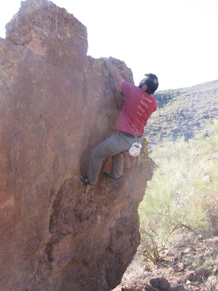 Topping out Snaggletooth. BEWARE - the big block to his left is very sketchy.
