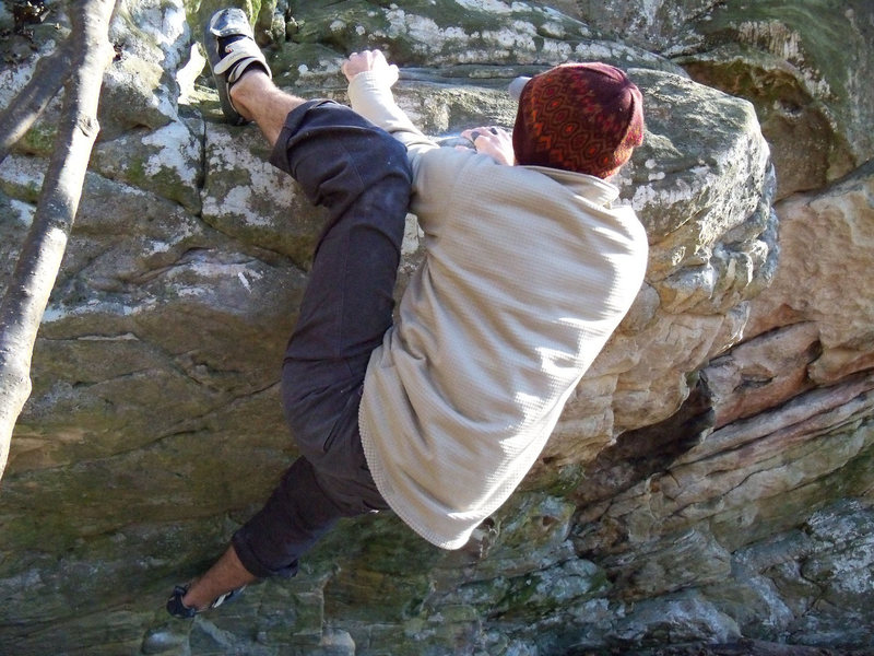 """Aaron Parlier adding the heel hook to grab the jugs behind on """"minima"""" (V-5)"""