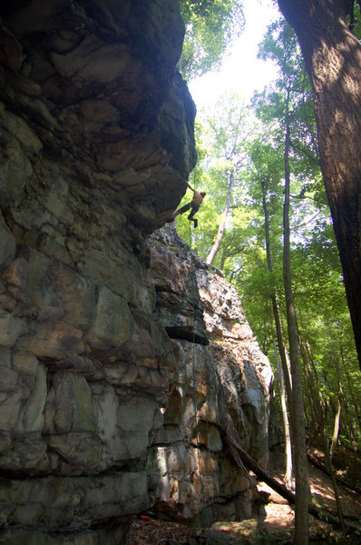 Laura rapping down Bruner Run Roof.  The route climbs the roof at the weakness to her left and up into the corner.