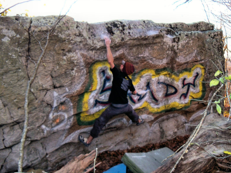 Rock Climbing Photo: Aaron Parlier sticking the left sloperlip version ...