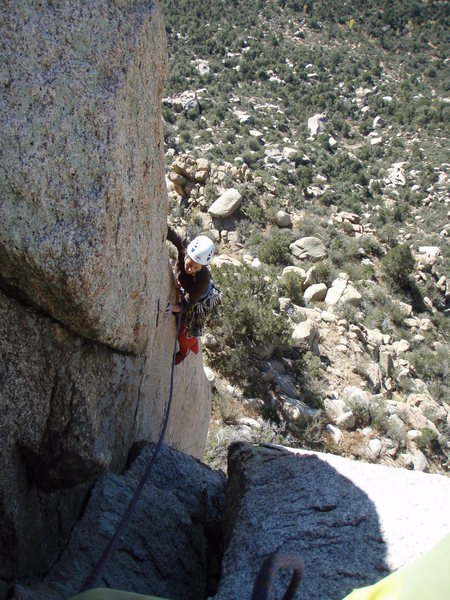 Contemplating the airy step across from Cat's Pajamas to the base of the final pitch of Reunion, Granite Mountain