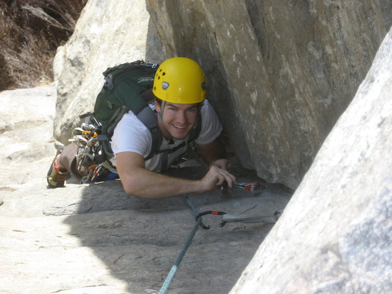 Me cleaning at neat rock on the standard route in the madison valley, Montana