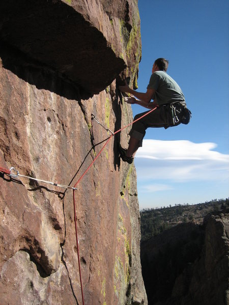 Scott Bennett at the under cling crux  en-route to punching his red point ticket.