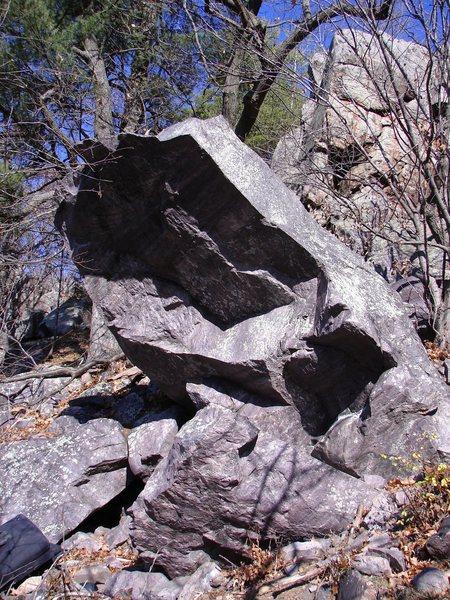 The Wave Rider goes up left side of boulder.