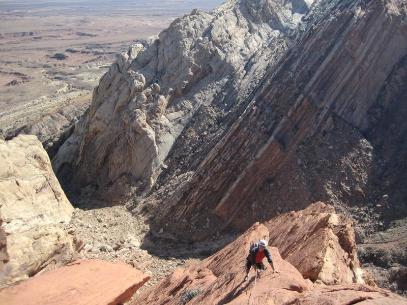 Paul following the final pitch ..way above the entrance of Three Fingers Canyon