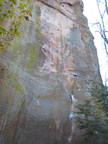 Super Slab.  Begin up the heavily chalked L-facing dihedral, and snake your way up towards the right-facing, right-leaning dihedral at the top.