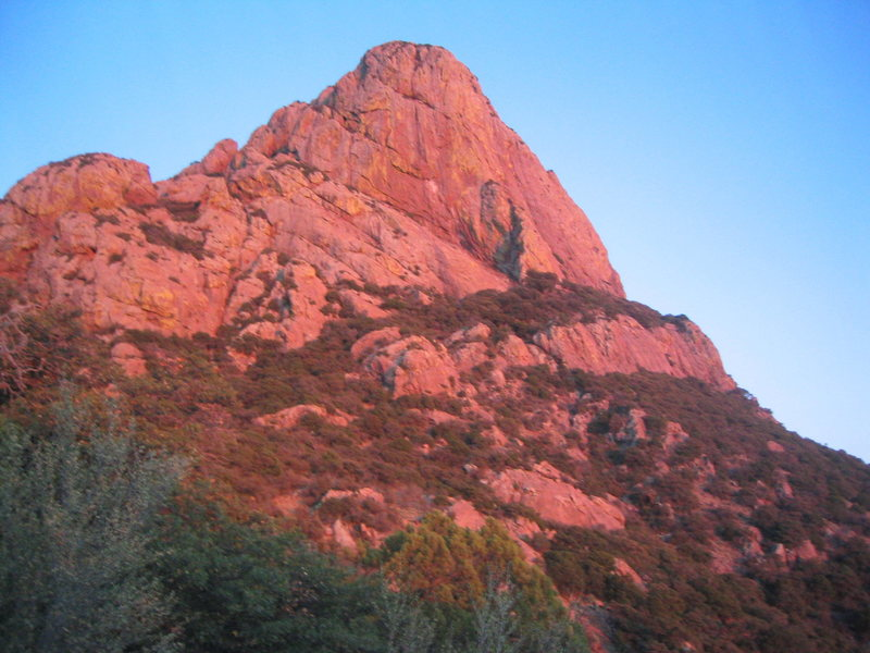 Profile of south face, with the Southeast Arete (5.6) in profile on the right.  Bathed in the light from the setting sun.