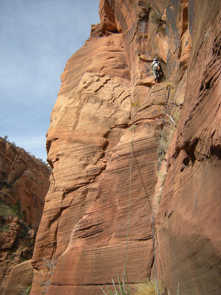 Pitch 5, steep climbing above a short tension traverse.