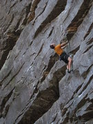 Rock Climbing Photo: Scoping out the crimp move at the 3rd bolt.