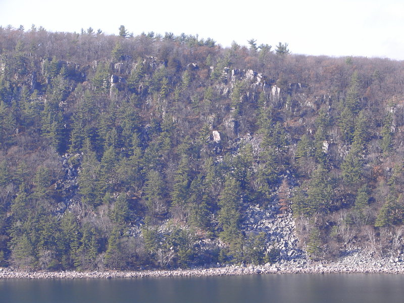 The Massive Vertigo area at the north end of the West Bluff.  The large boulder in the middle of picture is Happy Go Highball.