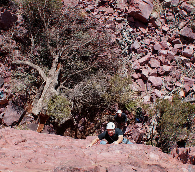 Chris on Giu La Testa; the now fallen Hanging Tree behind him.  Nestor belays.