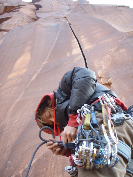 Rock Climbing Photo: Ginger tying in for Wounded Knee, Indian Creek