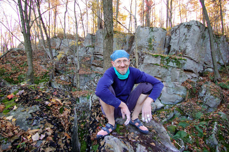 Bob Rentka perches happily atop a boulder he just ascended.