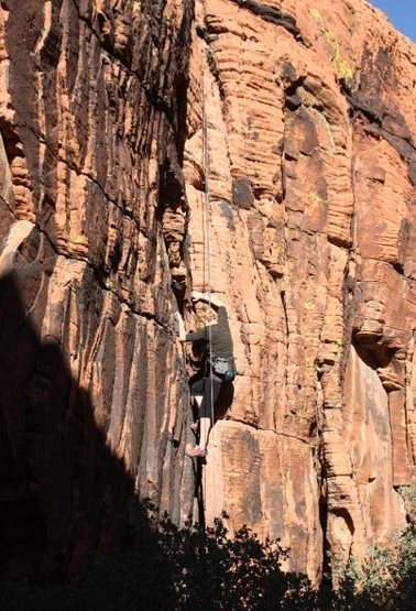 Working the large crack on 'The Broon' at New Castle Crag.