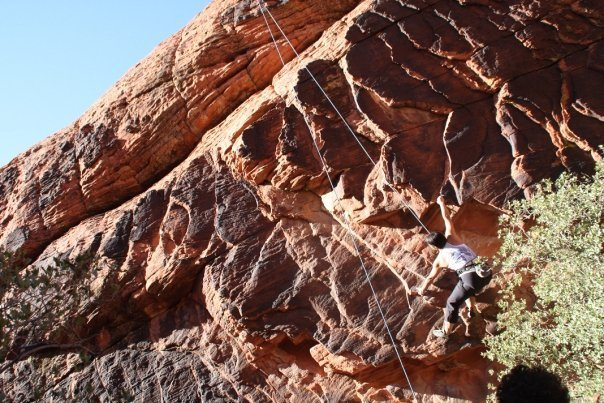 Moving to the overhanging rock edges on 'The Boila' at New Castle Crag.