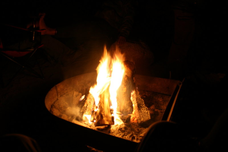 Night time around camp. Fire good, Fire warm.