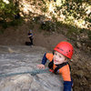 Bryson, nearly three years old, gets a belay from his grandmother, in San Ysidro Canyon.