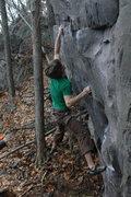 Rock Climbing Photo: Chris sticking the throw.