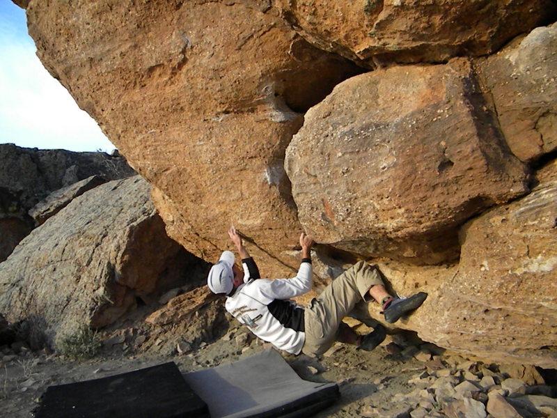 Rock Climbing Photo: David working out the sit-start.