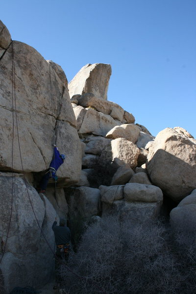 Al working the left crack on a wall behind Headstone rock