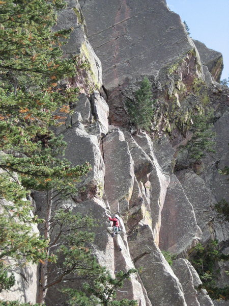 Me finishing up emerald city with the 5.6 crack of Over and Out and the 5.9 crack of Over the Hill looming over. Oct. '09.