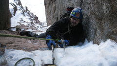 Rock Climbing Photo: Thomas finishing up a hardened-snow covered 1st pi...
