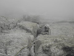 Rock Climbing Photo: Donny working it on the crux. Notice the fog in th...