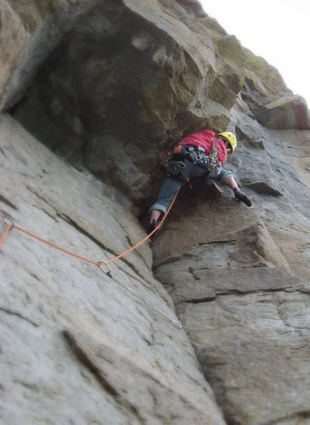 Entering the 10a crux of the 4th pitch around the right side of the roof.  Photo by Adam Sinner