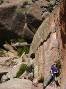 Rock Climbing Photo: Adam Sinner lounging at the top of P1.