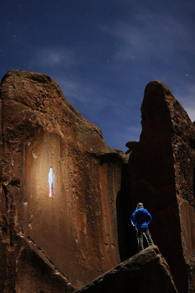 John ponders the Virgin Mary painting in Penitente Canyon, CO under a full moon.
