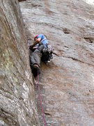Rock Climbing Photo: Hanging off a good jam to place gear.  Photo by Hu...
