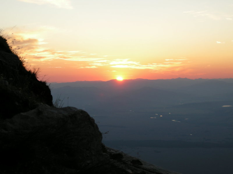 Pretty crappy sunrise near the summit of Teewinot. The snake river shimmers below.