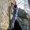 "Aaron Parlier with the fa of ""Domain"" (V-4). Maxima Boulder. Bluefield."